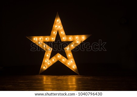 Decorative star with lamps on a background of wall. Modern grungy interior  #1040796430