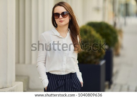 Young pretty woman walk on the street wear glasses and office clothing, spring time #1040809636