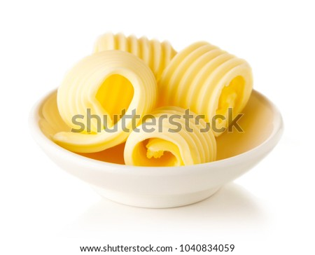Bowl of butter curls isolated on white background #1040834059