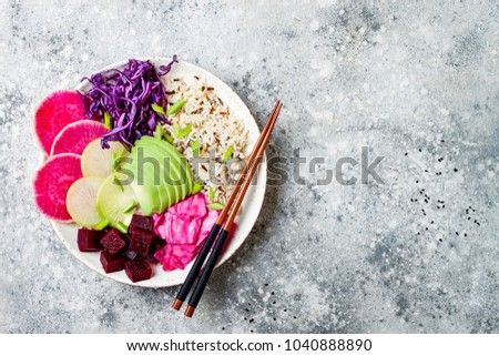 Vegan poke bowl with avocado, beet, pickled cabbage, radishes. Top view, overhead, flat lay #1040888890
