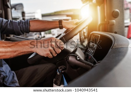 CDL Commercial Driver Inside of His Truck. Transportation Industry Theme. Royalty-Free Stock Photo #1040943541
