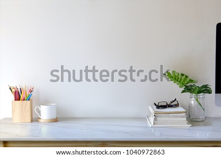 Contemporary workspace with books, colour pencils, gadgets and supplies. workspace and copy space #1040972863
