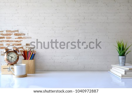 White desk table with copy space, supplies and coffee mug. Front view workspace and copy space Royalty-Free Stock Photo #1040972887