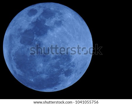 Big Blue Moon, Lunar. It is an astronomical body that orbits planet Earth. Royalty-Free Stock Photo #1041055756