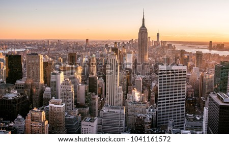 New York City - USA. View to Lower Manhattan downtown skyline with famous Empire State Building and skyscrapers at sunset. #1041161572