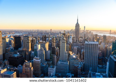 New York City - USA. View to Lower Manhattan downtown skyline with famous Empire State Building and skyscrapers at sunset. #1041161602