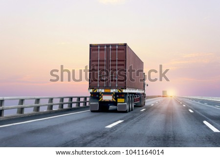 Truck on highway road with red  container, transportation concept.,import,export logistic industrial Transporting Land transport on the asphalt expressway with sunrise sky #1041164014