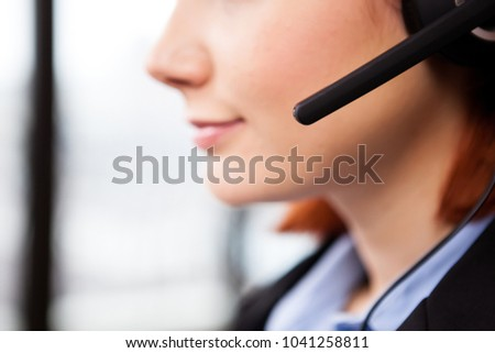 Close up of unrecognisable woman wearing a speaking handsfree headset #1041258811