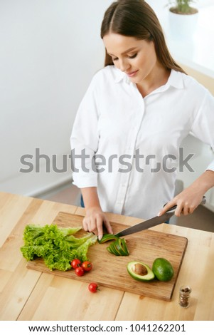 Nutrition. Woman Cooking Healthy Food In Kitchen. #1041262201