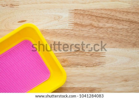 Empty colorful coin tray on wooden table - Small business concept #1041284083
