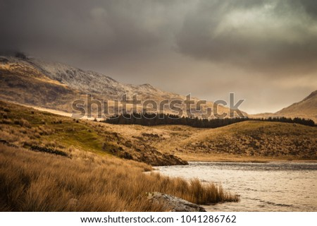 View across the lake to Mount Snowdon at Llyn y Dywarchen, as the sun lights the mountain side in the Snowdonia National Park, Wales. #1041286762