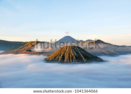 Bromo Mountain and fog around bromo mountain with sunrise from seruni viewpoint is an active volcano and part of the Tengger massif, in East Java, Indonesia. Indonesian call Gunung Bromo. Blue nature #1041364066