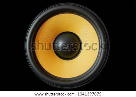 Subwoofer dynamic membrane or sound speaker isolated on black background, yellow Hi-Fi loudspeaker close up macro shot #1041397075