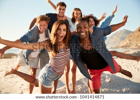 Portrait Of Friends Having Fun Together On Beach Vacation #1041414871
