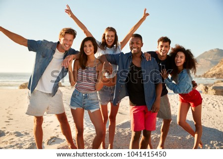 Portrait Of Friends Having Fun Together On Beach Vacation #1041415450