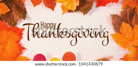 Illustration of happy thanksgiving day text greeting against autumn leaves on paper