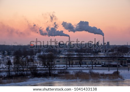 Chimney smoking stack. Air pollution and climate change theme. Poor environment in the city. Environmental disaster. Harmful emissions into the environment. Smoke and smog.  #1041433138