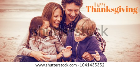 Digitally generated image of happy thanksgiving text against cheerful parents with children at sea shore