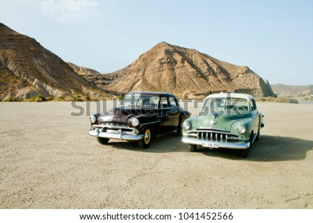 Tabernas, Almeria, Spain, august 14, 2017. Vintage cars in Desert Tabernas.Tabernas desert in AlmeriaIt is a famous place to make movies and TV ads. #1041452566