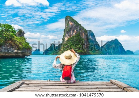 Traveler woman joy relaxing on wood bridge in beautiful destination island, Phang-Nga bay, Adventure lifestyle travel Thailand, Tourism nature landscape Asia, Tourist on summer holiday vacation trips #1041475570