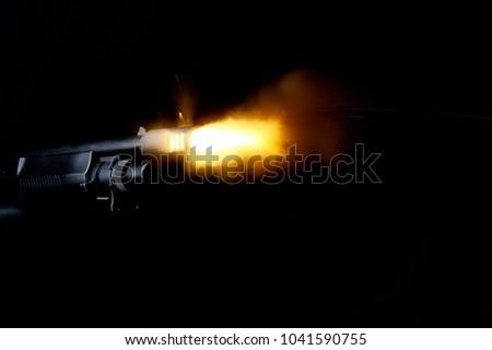 Shot of shotgun with muzzle flash #1041590755