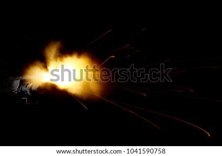 Shot of shotgun with muzzle flash #1041590758