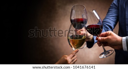 toasting with wine glasses #1041676141