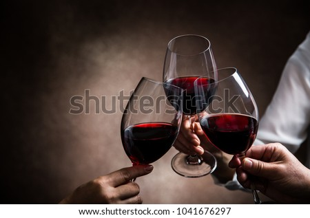 toasting with wine glasses #1041676297