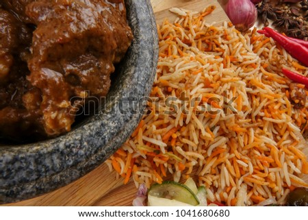 Nasi Briyani is a wholesome rice-based dish prepared with spices, rice, meat and vegetables. #1041680680