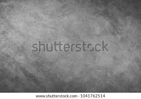 A gray black wall for inscriptions. Graphite wall. Wall for ads. Blackboard. #1041762514