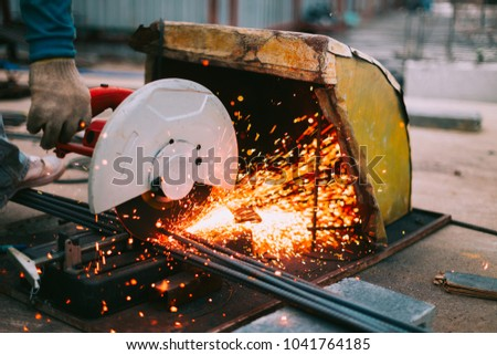 Cutting steel by Electric saw machine and worker,hot work,Construction work. #1041764185