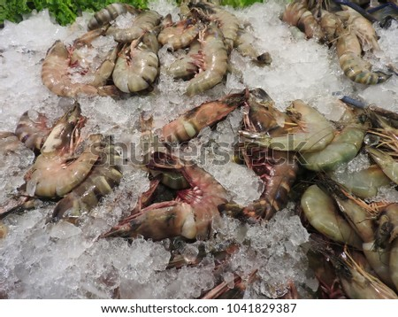 Prawns, lobsters, crabs, clams and squid at a Thai market #1041829387
