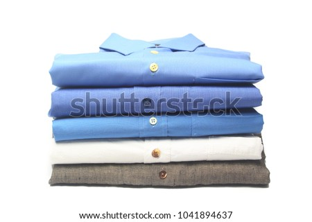 shirt folded and ironed in the dry cleaners Royalty-Free Stock Photo #1041894637