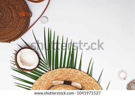 Feminine accessories, greem leaves and half of the coconut. Summer flat lay. Royalty-Free Stock Photo #1041971527