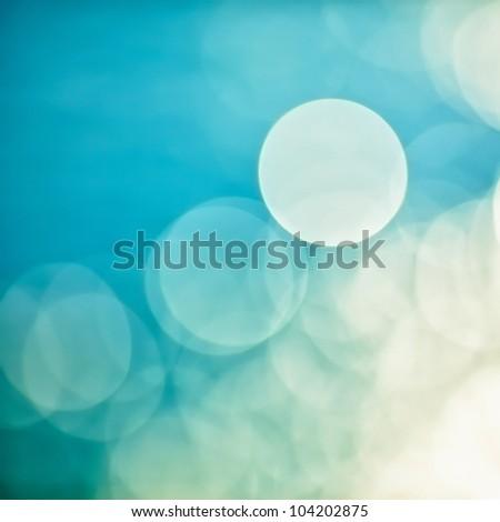 bright colorful sun and sea bokeh background #104202875