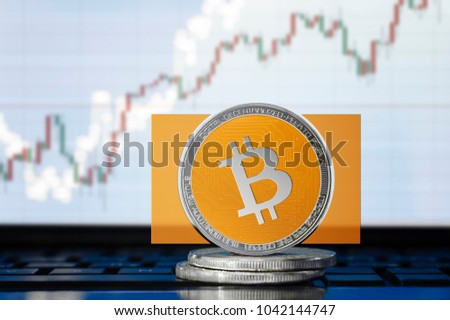 BITCOIN cash (BCH) cryptocurrency; physical concept bitcoin cash on the background of the chart #1042144747
