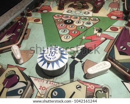Close Up of Old Pinball Wizard Machine Royalty-Free Stock Photo #1042161244