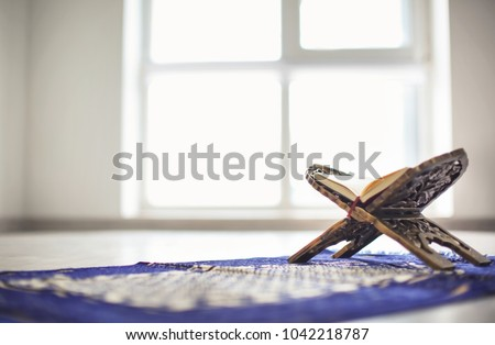Open holy book of Muslims on stand Royalty-Free Stock Photo #1042218787