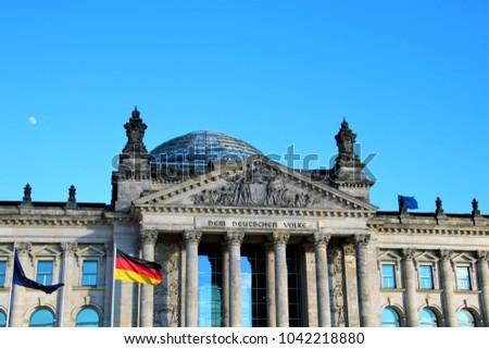 Bundestag facade, flag and moon #1042218880