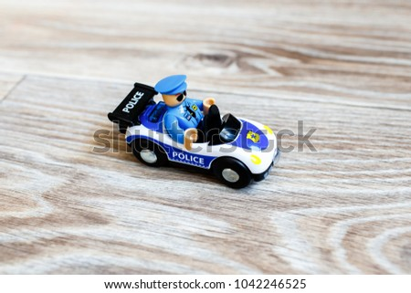 toy police car with an officer