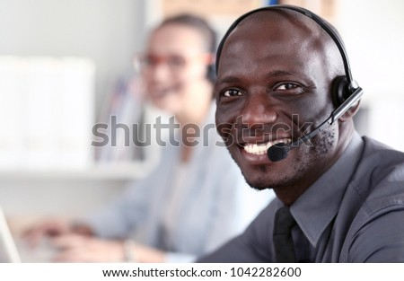 Portrait of an African American young business man with headset. #1042282600