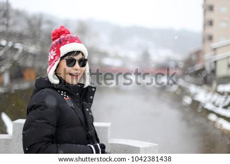 The Asian tourist woman in Takayama, Japan. #1042381438