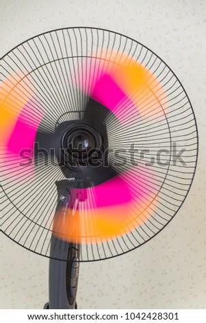 The fan of the stand. Copper retro fan. Vintage electric fan. Metal fan. Pedestal. Cooling fans #1042428301