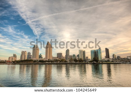 Skyline of San Diego, California on a bright sunny day with building reflections in the water and a cloudy sky. This is a high dynamic range image. / San Diego Skyline