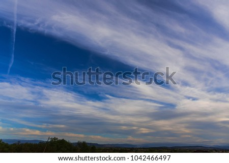 Fantastic clouds at the sunset #1042466497