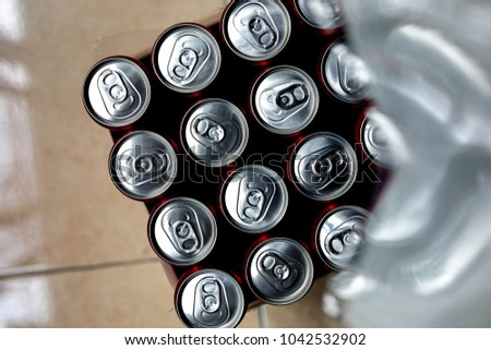 close Up of a group of aluminium cans.Cover aluminum cans. Aluminum cans. Top view. Aluminum cans. #1042532902