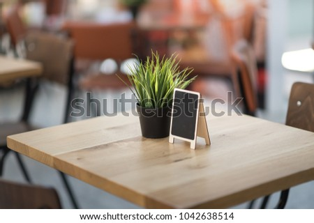 Vase with green grass on the restaurant cafe table. in international airport