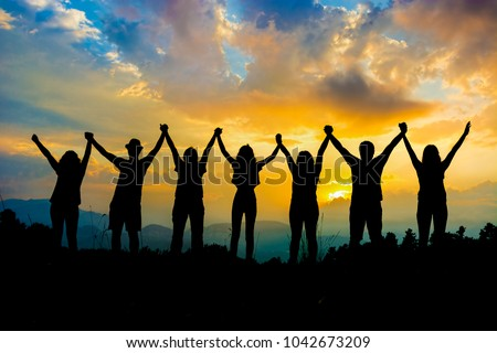 friends silhouette holding hand in hand Royalty-Free Stock Photo #1042673209