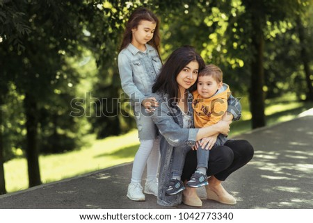 Mom son daughter outdoors, outdoors, in the Park. Happy family #1042773340
