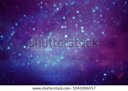 glitter vintage lights background. purple, blue and pink. de focused #1043086057